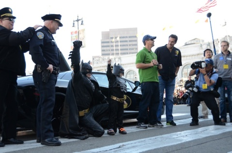 Batkid and Batman arrive at San Francisco City Hall to meet the mayor.