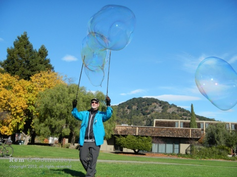 Ray J. Doubleday makes large bubbles in San Rafael's Albert Park.
