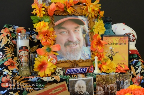 Tom Maurer is remembered fondly with his Neil Young DVD and SF Giants and 49ers memorabilia on display at his Dia De Los Muerto altar.