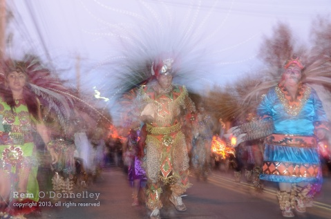 Members of the Mixcoalt Aztec Dancers lead the Dia De Los Muertos procession in San Rafael