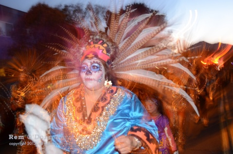 A woman with the Mixcoalt Aztec Dancers had an elaborate Day of the Dead face painting in San Rafael