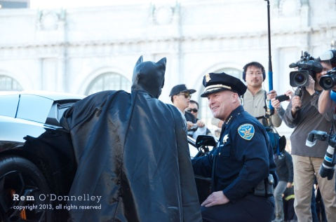 Batman has a chat with San Francisco Police Chief Greg Suhr at city hall.