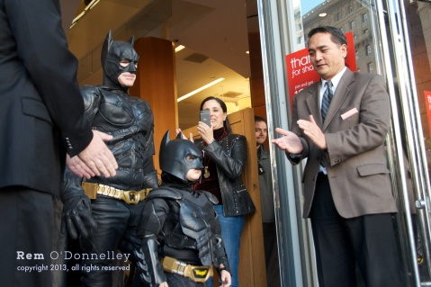 Batman and Batkid exit Macy's to cheering crowds in San Francisco's Union Square.
