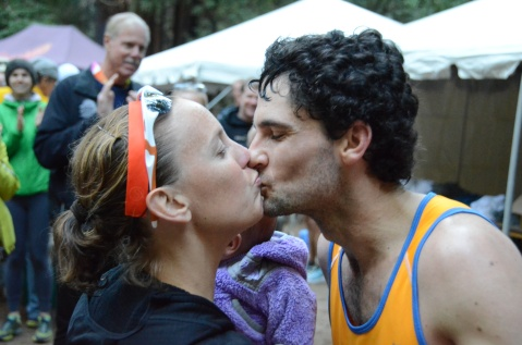 Brett Rivers shares a kiss with his wife after coming in second in the 2013 Quad Dipsea in Mill Valley, California.